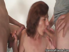 grandma-enjoys-two-young-cocks