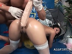 slutty-brunette-cunt-nailed-with-a-fist-and-huge-dildo