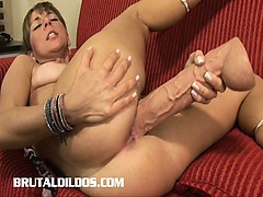 patricia-barely-squeezes-two-giant-dildos-in-her-tight-pussy