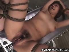 asian-bondage-scene-with-rope-suspension