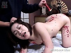 asian-sweet-babe-gets-hot-wax-dripped-on-naked-body