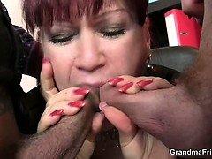 hot-business-lady-takes-two-dicks