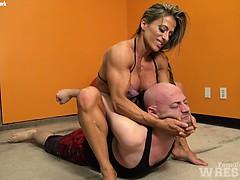 muscular-blonde-wrestles-wimp