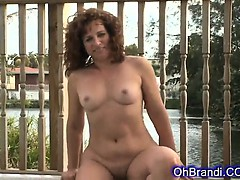 sexy-brunette-milf-with-a-round-juicy-ass