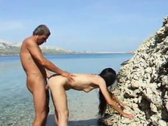 mature-couple-fucking-at-the-beach