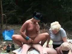 tanned-slut-and-granny-slut-are-sucking-big-cock