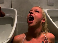 piss woman drinks warm pee in urinal