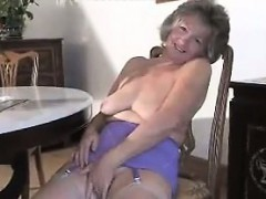 cute granny doing a striptease
