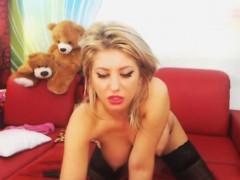 busty-blonde-shemale-masturbating-her-big-cock