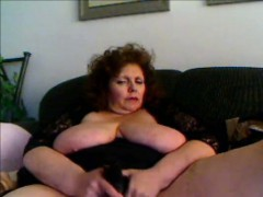 hot-amateur-granny-fucks-herself-with-black-sex-toy