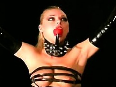 busty-blondie-tied-and-submitted-in-a-pervs-dark-dungeon