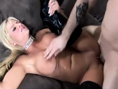 sex-on-a-couch-in-shiny-black-boots-over-stockings