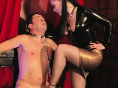 glam-british-dominatrix-trampling-subs-cock