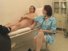 female-doctor-examines-a-cock
