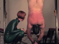 dominating-redhead-flogging-sub-in-a-bodysuit