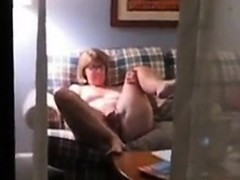 housewife-nancy-caught-dildoing-on-the-couch
