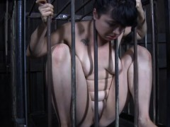 caged-sub-inserts-chess-piece-into-her-pussy