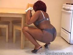 fat-ebony-behind-is-shown-as-mistress-cleans-her-table