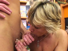 sexy blonde mature bangs him in the video store