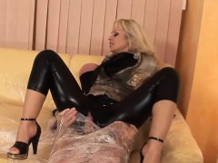 clothed blonde babe pleasures a hard penis