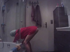 hidden-cam-catches-a-babe-getting-out-of-the-shower-and-dre