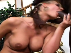 Busty Blonde Cougar Has A Black Stick Working Its Magic In Her Peach
