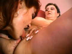 hot-redheaded-woman-lets-this-short-haired-lesbian-suck-on-her-clit