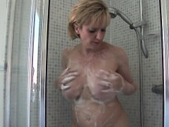 cheating british mature lady sonia flashes her enormous boob