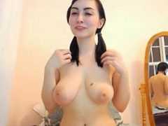 brunette-shows-her-ass-from-the-back-and-her-natural-big