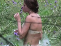 brunette-is-in-the-woods-and-takes-off-her-clothes-for-a-li