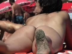 sexy slut enjoys sunbathing without her swims