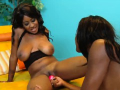 Two hot ebony lesbians enjoy sex toys in their pussies