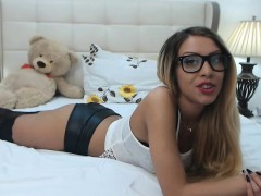 nerdy blonde slut in black stockings spreads her body acros