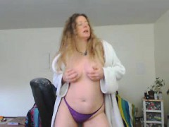 blonde cougar opens her white robe to fondle her tits on we