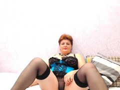 buxom-mature-brunette-in-a-green-and-black-teddy-shows-off