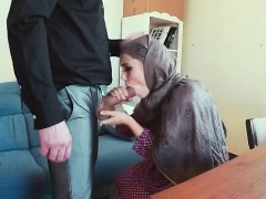 arab in head scarf blowing cock from desk in office