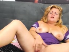 busty-blonde-mature-masturbates-with-yellow-sextoy