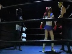 cute-asian-fighter-gets-thrown-on-the-mat-and-wrestles-topl