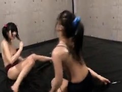 asian-babes-are-all-oiled-up-and-wrestling-while-ripping-of
