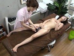 slender-asian-girl-lies-on-the-massage-table-and-is-made-to