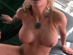 Huge tits MILF pussy banged on a car top