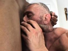 old-muscleman-lets-a-huge-black-shaft