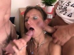 Mature woman in fishnets swallows two dicks