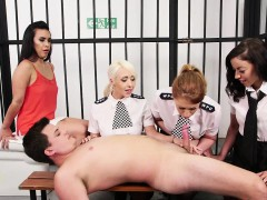 female-british-cops-tugging-sub-in-his-cell