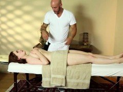Busty Redhead Tugging Cock On Massage Table