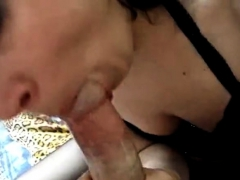 Furiously Sucking On Condom Cock