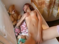 redhead-babe-undress-on-the-window