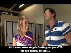 adorable-blonde-teen-cheerleader-talking-with-her-teacher