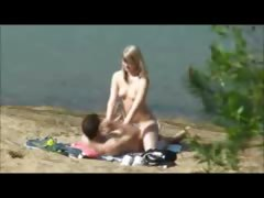 peeper-catches-a-hot-blonde-blowing-and-riding-on-the-beach