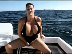 milf-with-big-natural-boobs-sits-on-her-dildo-in-my-boat